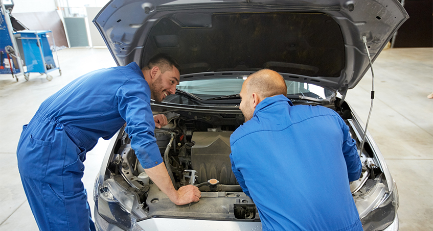 Two mechanics checking over a vehicle - Car Servicing Penrith